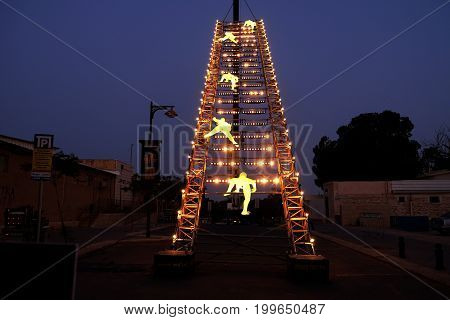 BEER SHEVA ISRAEL - AUGUST 09 2017: Festival of Light in Beer Sheva 2017. Stairway leading to the sky. Inscription: Announcement of the festival