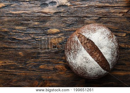 whole fresh loaf of round rye bread with a crispy crust. Space for text