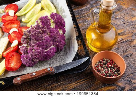 Different vegetables for baking on a baking sheet. Healthy organic food and spices