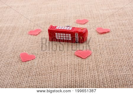 Red Hearts Around Red Color Phone Booth