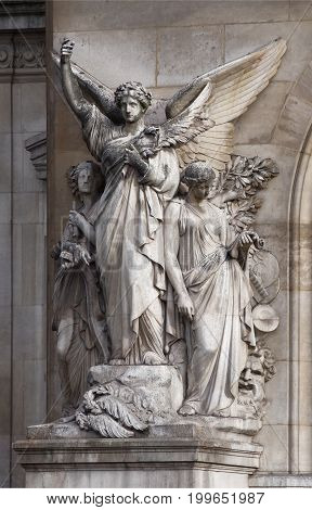 ParisFrance- April 30 2017: Opera Garnier. A composition that symbolizes the pillars of theatrical art. This
