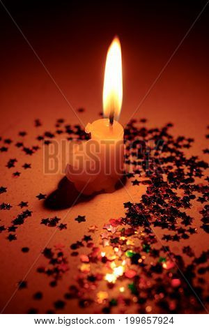 Candles Light And Star Confetti With Soft Light Blurred Backguond