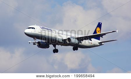 FRANKFURT, GERMANY - FEB 28th, 2015: A Lufthansa Airbus A321-200 - MSN 6415 - D-AIDW - lands at Frankfurt International Airport FRA with cloudy sky in the background.