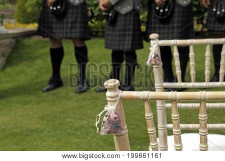 Men wearing traditional kilts at a Scottish wedding