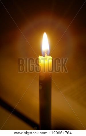 Candles Light With Open Blurred  Book Background In The Church.education Concept.