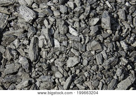 Coal mineral black cube stone background. textured