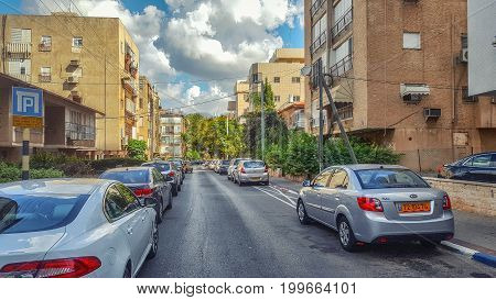 Rishon LeZion Israel-September 23 2016: The typical Israeli street called Nili in old city center built up in the early seventies. Most of these condominiums are 3 or 4 story residential buildings