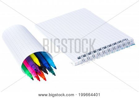 Open spiral blank notebook with color markers on white background. Studio Photo