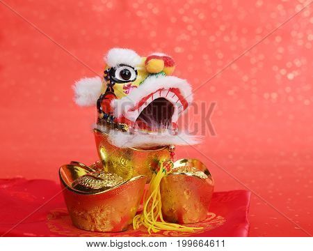 traditional chinese dancing lion with Gold ingot,Chinese calligraphy Translation:good bless for money