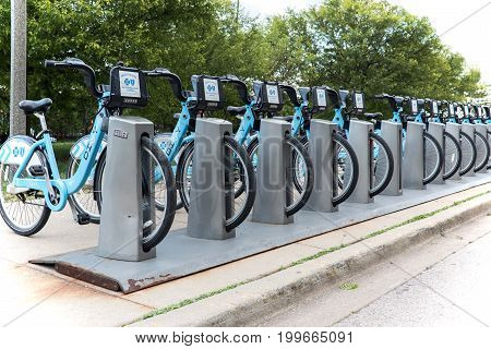 Chicago, IL, USA - June18 2017. A slender row of bicycles on bicycle parking