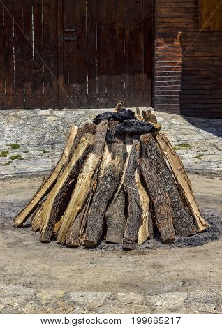 beauty stacked dry wood and coal for the hearth
