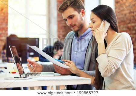 Startup Diversity Teamwork Brainstorming Meeting Concept.Business Team Coworkers Sharing World Economy Report Document Laptop.People Working Planning Start Up.Group Young Hipsters Discussing Cafe