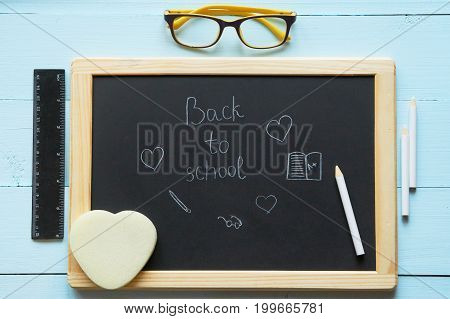 Top View Of Chalkboard With Back To School Title