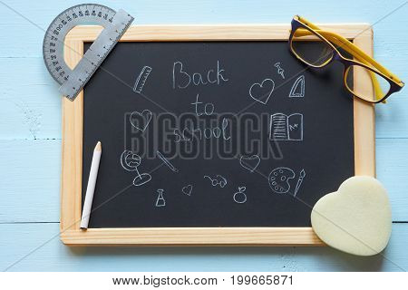 Hand Drawing Back To School On A Chalkboard