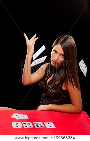 Young Woman Throw Playing Cards