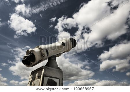 Telescope looking at the sky with clouds