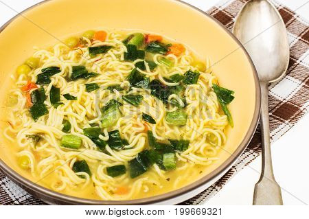 Vegetarian vegetable soup with vermicelli and spring onions. Studio Photo