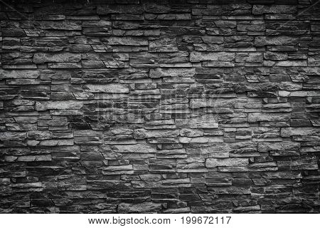Black stone wall. Texture for your design.