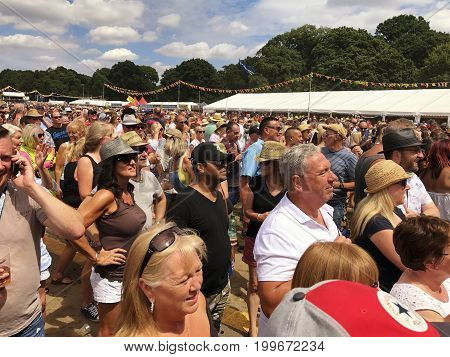 SOUTHAMPTON UK - July 8 2017: Lets Rock Southampton 80s music festival in Southampton UK. Crowd watching a performance on the stage.