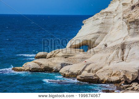 Rocks of white limestone form arches and grottoes on the shores of the Mediterranean Sea. The grottoes of Rosh Ha Nikra. Geological phenomenon in the north of Israel
