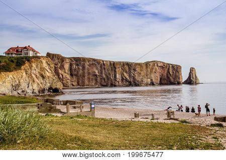 Perce Canada-10 August 2017 : View of Perce Rock at summer sunset. Perce Rock is a huge sheer rock formation in the Gulf of Saint Lawrence on the tip of the Gaspé Peninsula in Quebec Canada off Percé Bay.