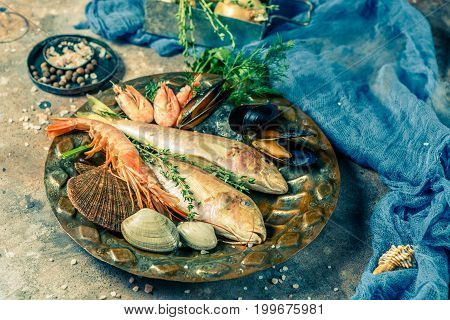 Photo of seafood on plate on stone table, photo above