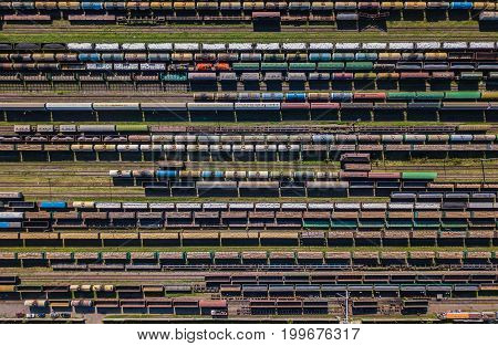 Aerial view of colorful freight wagons on the railway station