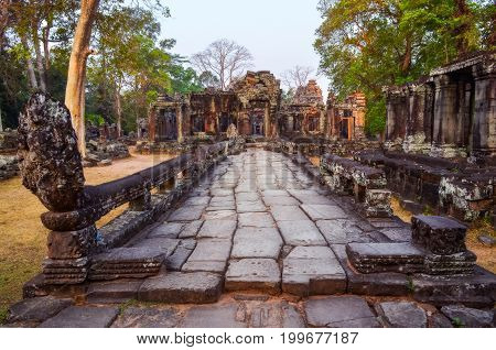 Weathered Stone Road And Ancient Temple Ruins In Angkor Wat