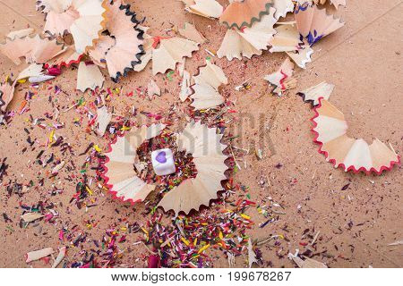 Heart shaped object amid colorful pencil shavings