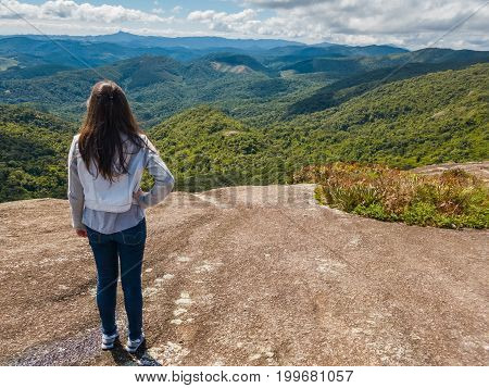 Young Beautiful Girl Stands At The Top Of  A Mountain In  Monte Verde, Minas Gerais, Brazil.