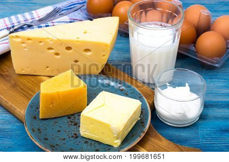 Dairy products as background of healthy food on blue. Studio Photo