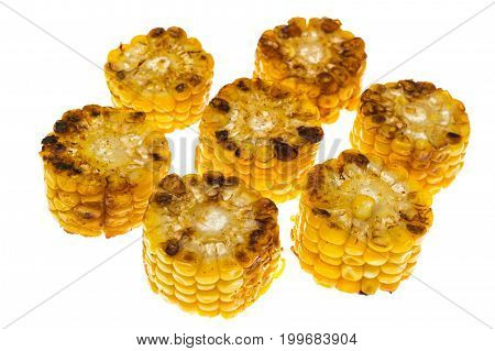 Fried corn cob, cut into pieces. Studio Photo