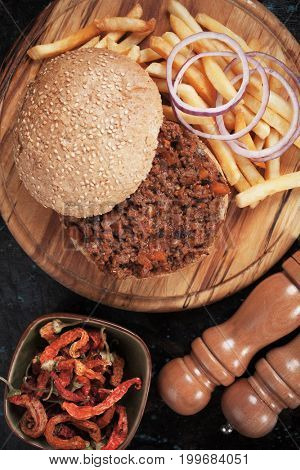 Sloppy joes beef burger sandwich with onion and french fries