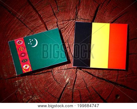 Turkmenistan Flag With Belgian Flag On A Tree Stump Isolated