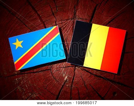 Democratic Republic Of The Congo Flag With Belgian Flag On A Tree Stump Isolated