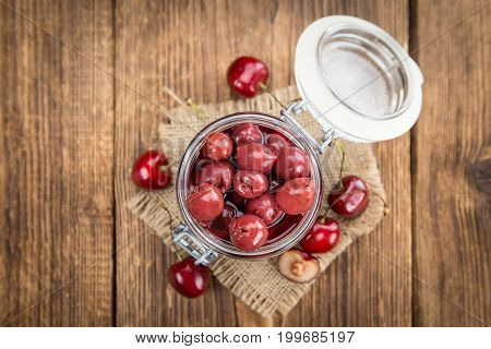 Portion Of Canned Cherries On Wooden Background, Selective Focus