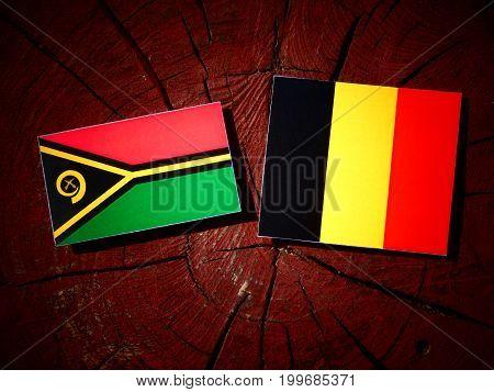 Vanuatu Flag With Belgian Flag On A Tree Stump Isolated