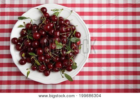 Bowl of sour cherry on a kitchen table