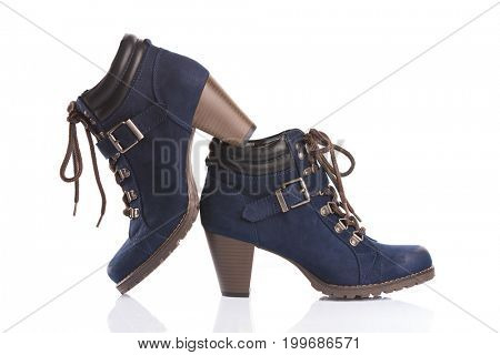 Navy blue ankle boots with chunky heels, isolated on white background
