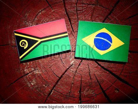Vanuatu Flag With Brazilian Flag On A Tree Stump Isolated