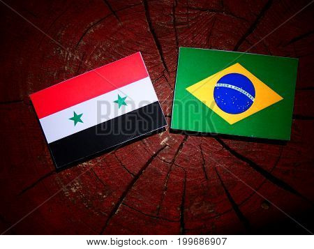 Syrian Flag With Brazilian Flag On A Tree Stump Isolated