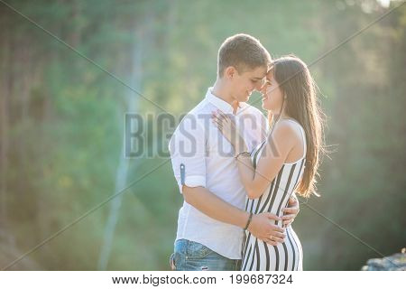 Young couple going to kiss outdoors on summer day
