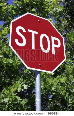 Stop Sign With Tree Background