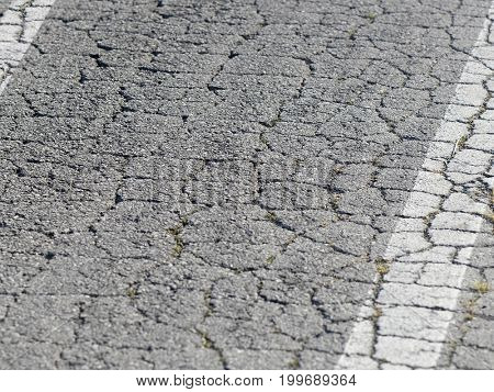 Background with the image of crackle asphalt