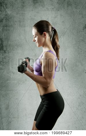 Beautiful Sporty Muscular Woman With Two Dumbbells