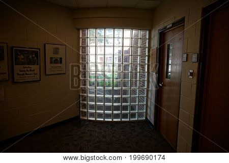 JOLIET, ILLINOIS / UNITED STATES - JULY 17, 2017: A wall, made of glass blocks, in the Harold and Margaret Moser Performing Arts Center, at the University of Saint Francis.
