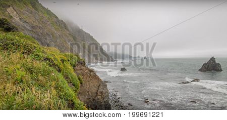 Cliff overlooking the sea on a cloudy day
