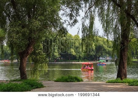Shenyang, Liaoning, China - July 20, 2013: People having a good time on a boats in Beiling Park in summer