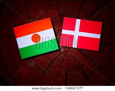 Niger Flag With Danish Flag On A Tree Stump Isolated