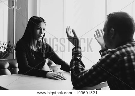 Young couple arguing in a cafe. Relationship problems